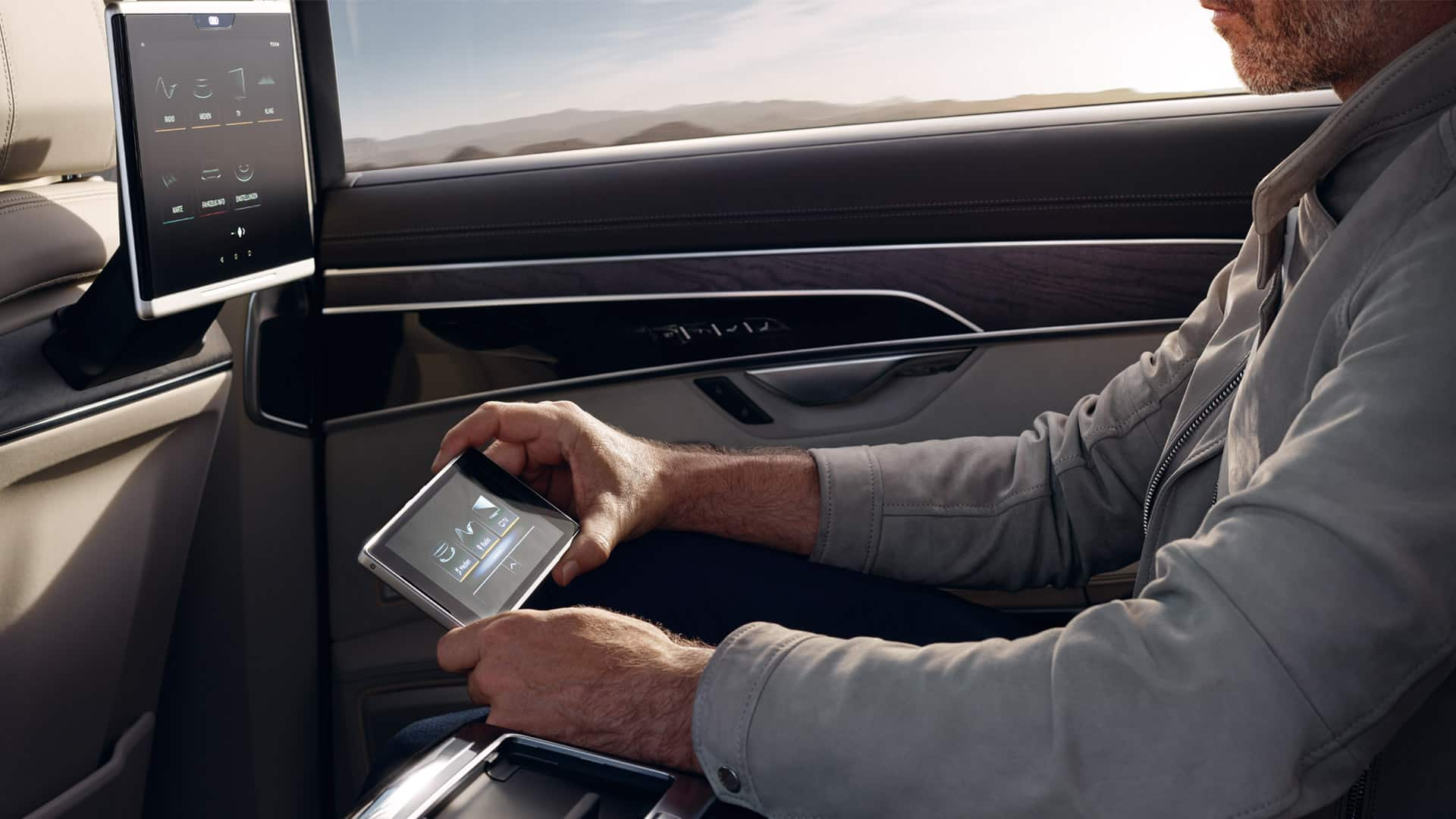 The new audi a8 audi jamaica rear seat remote important settings and media functions can be controlled from the rear via the removable 57 inch touch display in oled technology sciox Image collections